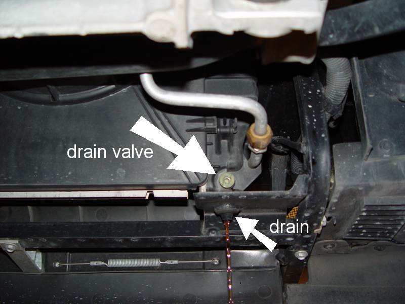 Fig.3 Draining the coolant. You can see the drain valve and the drain cock here.